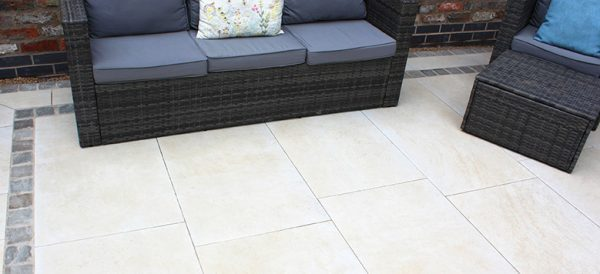 Traverta Classic Cream shown with Natural Paving Pewter Cobbles